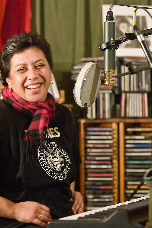 Mahinarangi Tocker recording her album, the Mongrel In Me, on Monday 25 July 2005.  The band consist of Shona Laing, James Wilkinson, David Downes, Anahera Higgins, Denny Stanway and Jimmy Young, with recording / production by Robbie Duncan at his Braeburn Studio in Wellington New Zealand.