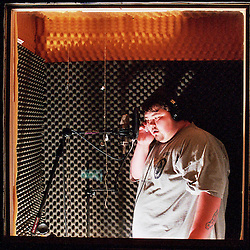 Big Seeds of the Blue Collar Boys adds back up vocals to a track during a recording session at a studio in Bowling Green, Kentucky.