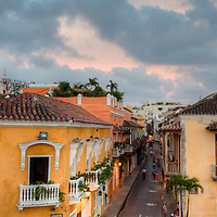 A colorful sky at sundown compliments the colorful streets of downtown Cartagena, Colombia.