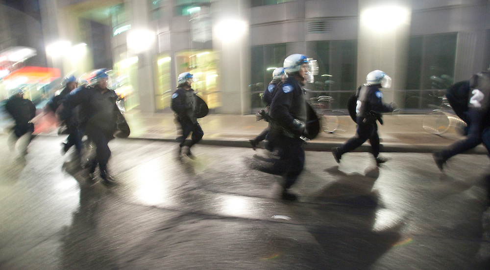 Riot police in Toronto, Canada work into the night June 26, 2010, to quell protests in the downtown core near the G20 summit site. <br /> AFP/GEOFF ROBINS/STR
