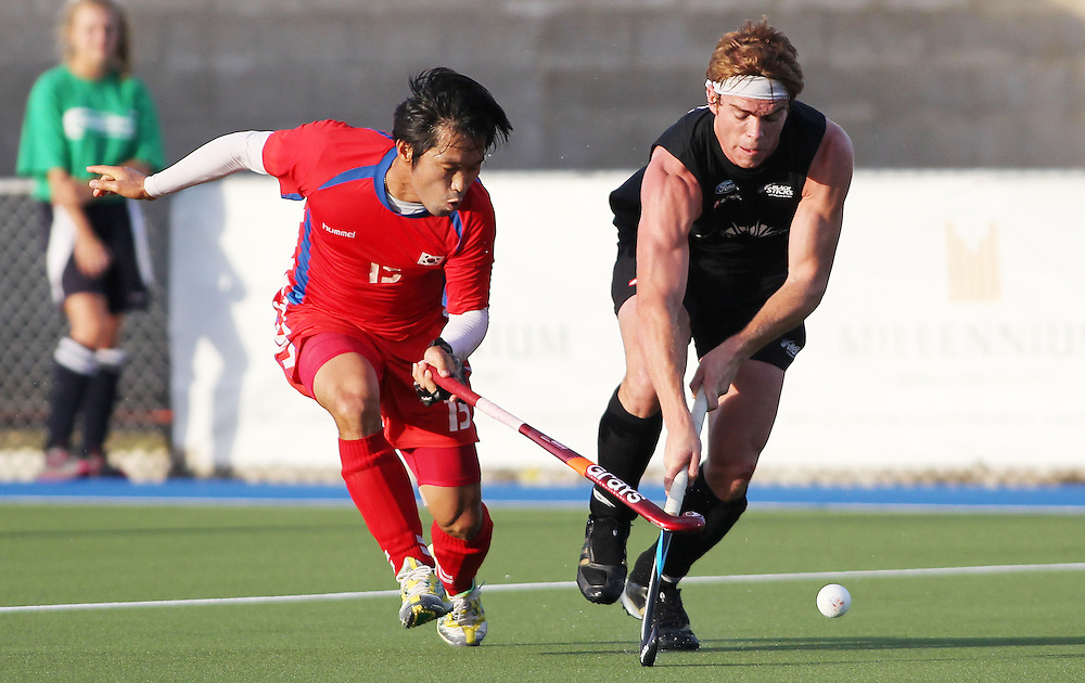 New Zealand's Andy Hayward clashes with Korea's Woon Kon Yeo during their international hockey match at Lloyd Elsmore Hockey Stadium, Auckland, New Zealand, Thursday, February 09, 2012. Credit:SNPA / Ben Campbell..