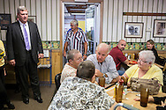 Vice President Joe Biden talks with Sandra Axdale, Barb Baker, Kim Thompson, and.Char Thompson during an unannounced stop at the Good Earth Restaurant as Agriculture Secretary Tom Vilsack, left, looks on during a two-day campaign swing through Iowa on Monday, September 17, 2012 in Muscatine, IA.