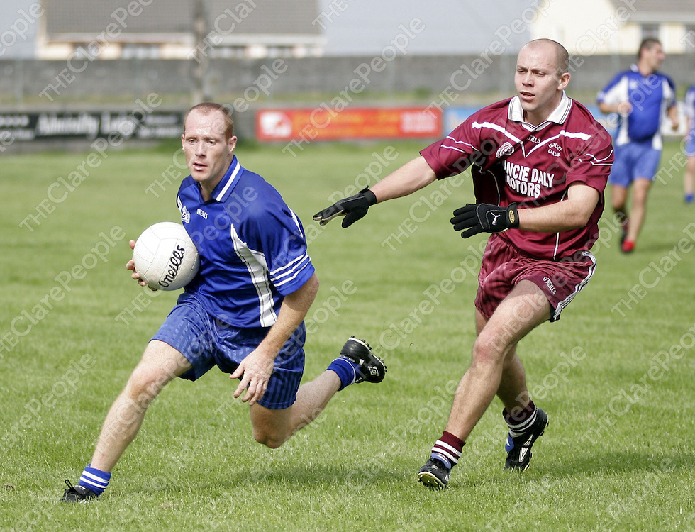 Kilballyowen's Michael Liddane holds posession despite the pressure of Lissycasey's Brendan McNamara in Quilty on Saturday.<br /> <br /> Photograph by Yvonne Vaughan.