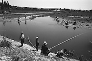 Men fishing to supplement their income near the city of Osh, once one of the great cities of the Silk Road and of Central Asia, and the second biggest city in the country, situated in the unstable Ferghana valley which is now becoming a hotbed if Islamic Fundamentalism, Osh,  Kyrgyzstan.