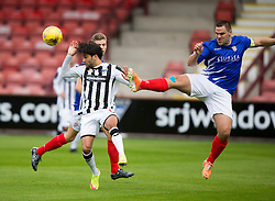 Dunfermline's Faissal El Bahktaoui and Cowdenbeath's John Armstrong. Half time : Dunfermline 0 v 0 Cowdenbeath, Scottish League Cup game played today at East End Park.