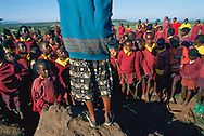 Masai children gather from opening ceremonies at Kimuka Primary school in Kenya's Rift Valley.  Adapting to a shrinking supply of cattle land, Masia herders are bearing fewer children in hopes of sending all their sons and daughters to school.
