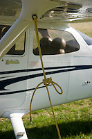 Detail of a tie-down rope on a Cessna 172