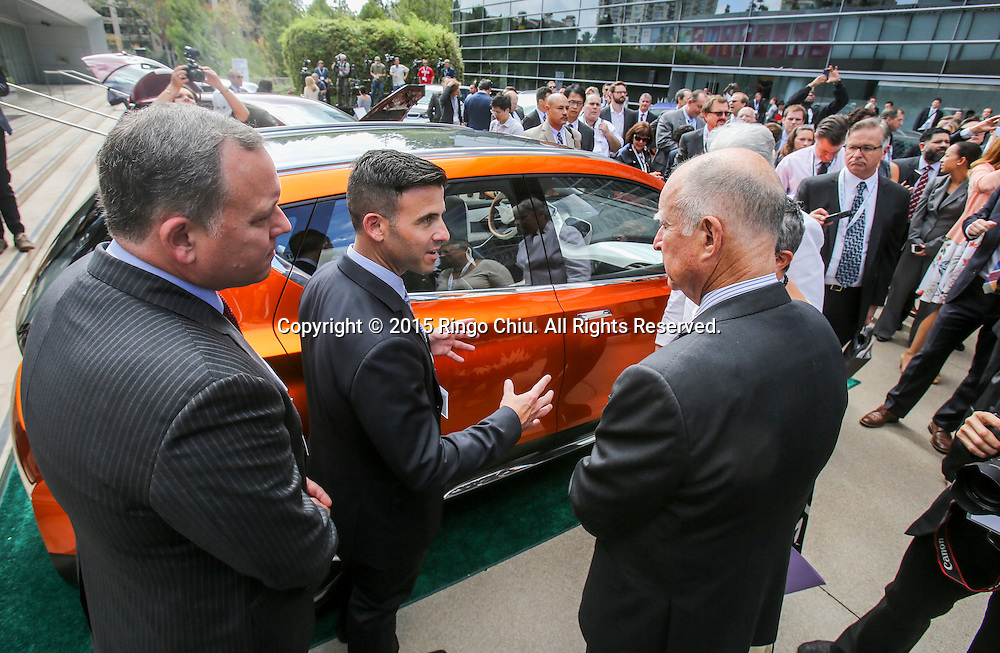 California Gov. Jerry Brown, right listens as Shad Balch of General Motors, introduces the Chevrolet Bolt EV concept car in Drive the Dream 2015 event at Creative Artists Agency in Los Angeles October 15, 2015.  (Photo by Ringo Chiu/PHOTOFORMULA.com)