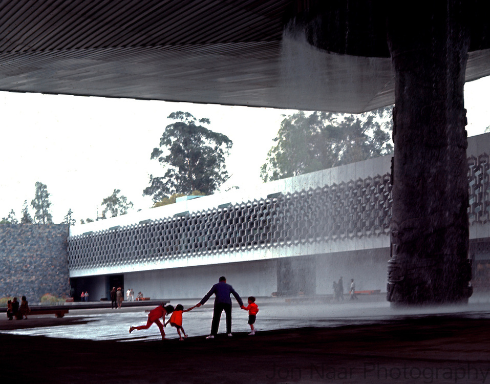 Architect Jaime Lopez  Bermudez and his children playing in front of fountain at the Anthropology Museum in Mexico City in 1962.  6x7 cm format taken with Veriwide.