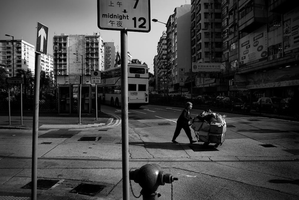 Woman pushing a trolley of goods, Sham Shui Po, New Territories, Hong Kong, 2007.