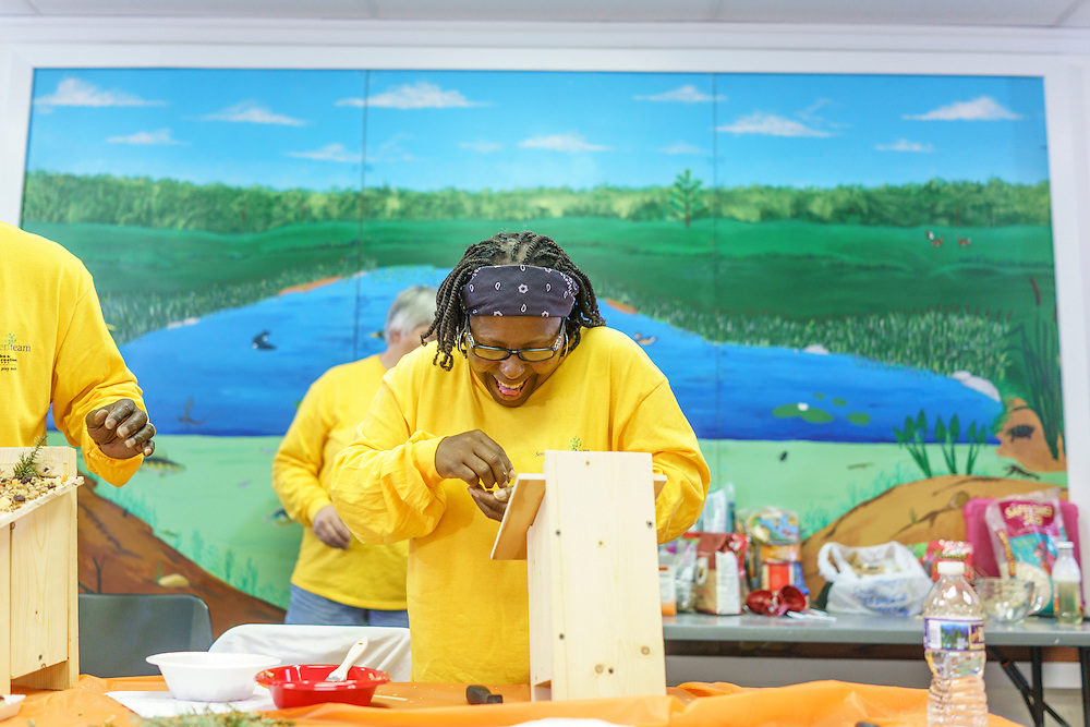 Upper Marlboro, Maryland - January 03, 2017: Carolyn Harris, member of the Senior Green Team builds and decorates a birdhouses at the Watkins Park Nature Center in Upper Marlboro, Md., Tuesday January 3, 2017. The group meets the first Tuesday morning of each month and works on nature beautification projects like trail maintenance, tree planting, clean ups, and, educational outings. <br /> <br /> CREDIT: Matt Roth