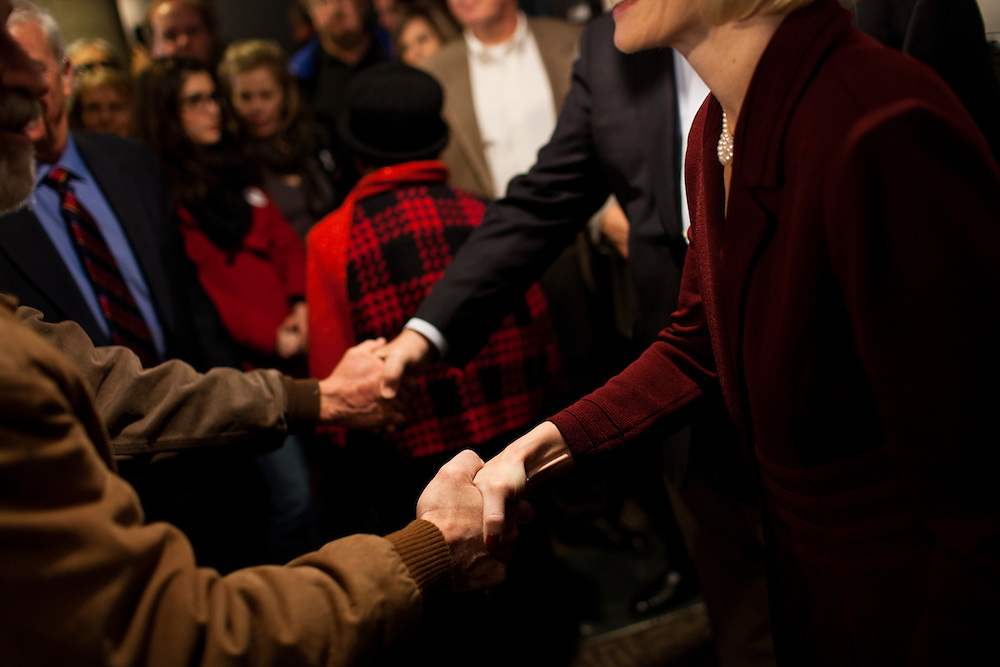 Republican presidential candidate Newt Gingrich, rear, and his wife Callista Gingrich shake hands with attendees at a campaign stop at Tish's Restaurant on Saturday, December 31, 2011 in Council Bluffs, IA.