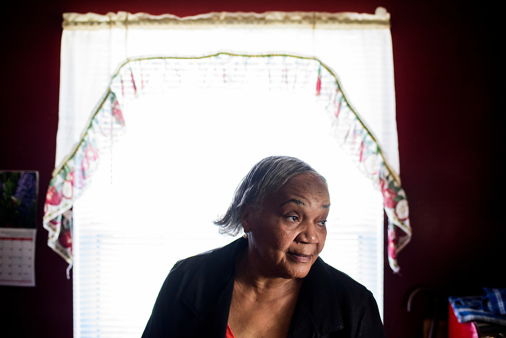 Washington, D.C. - March 29, 2017: Claudette Craig, Charles &quot;Chuckie&quot; Craig's mother, is photographed in her Washington DC home Wednesday March 29, 2017. She's lost two of her five children to gun violence. Charles &quot;Chuckie&quot; Craig, Kevin Durant's coach and mentor, was gunned down April 30th, 2005 in Laurel, Md., at the age of 35. Durant wears #35 as tribute to Craig.<br /> <br /> Her eldest, Ryan, a marine, was killed during a family visit to Georgia by a rival of his cousin when he was 20-years-old. <br /> <br /> NBA Superstar Kevin Durant's jersey number &quot;35&quot; is a tribute to his rec. league coach and mentor Charles &quot;Chuckie&quot; Craig, who was gunned down in at a night club in Laurel, Md., in 2005 when he was 35 years old. <br /> <br /> CREDIT: Matt Roth for The New York Times<br /> Assignment ID: 30204524A