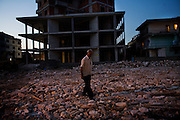 Street scene in Vlore. new apartment buildings and rubble