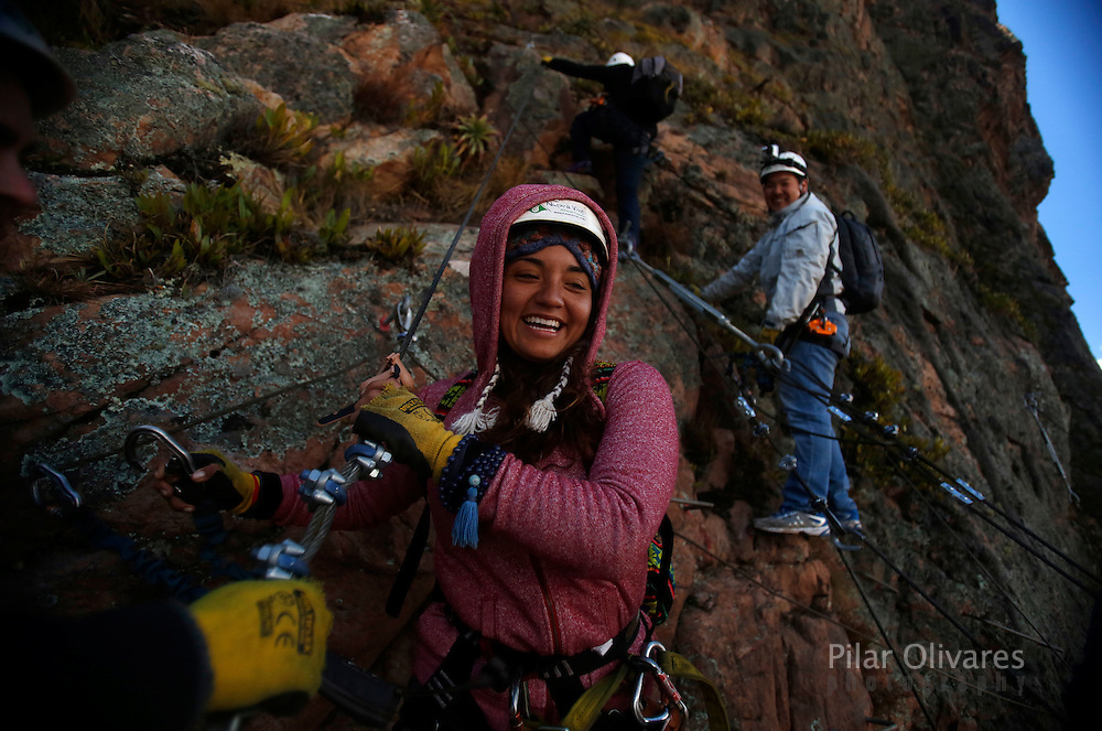A guest smiles as she leaves the <br /> Skylodge Adventure Suites in the Sacred Valley in Cuzco, Peru, August 14, 2015. The Skylodge is composed by three capsule suites hanging at the top of the 1300 feet mountain with a 300 degree view of the Valley. To sleep at Skylodge, people must climb 400 meters of Via Ferrata path and to leave the hotel people go down  a trail through ziplines. REUTERS/Pilar Olivares