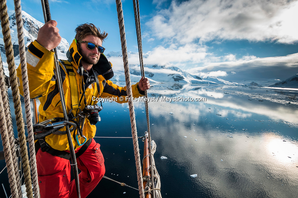 Antarctica, February 2016. Looking out from the top of the main mast of Europa. Paradise is a gorgeous bay surrounded by high mountains and huge glaciers fronts, where the Argentinean Station Brown is located. Dutch Tallship, Bark Europa, explores Antarctica during a 25 day sailing expedition. Photo by Frits Meyst / MeystPhoto.com