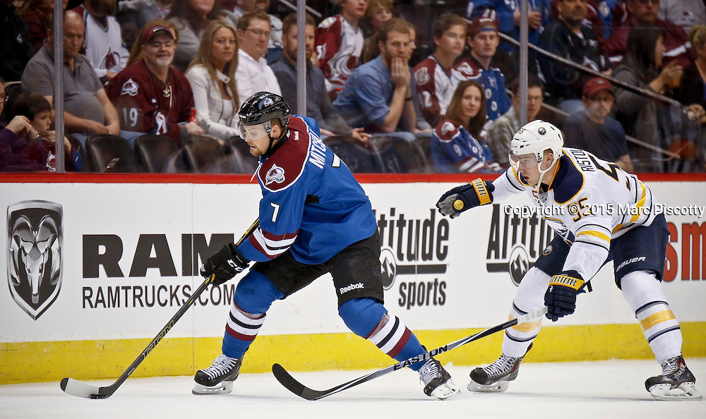 SHOT 3/28/15 7:17:33 PM - The Buffalo Sabres' Rasmus Ristolainen #55 plays defense against the Colorado Avalanche's John Mitchell #7 during their regular season NHL game at the Pepsi Center in Denver, Co. The Avalanche won the game 5-3. (Photo by Marc Piscotty / © 2015)