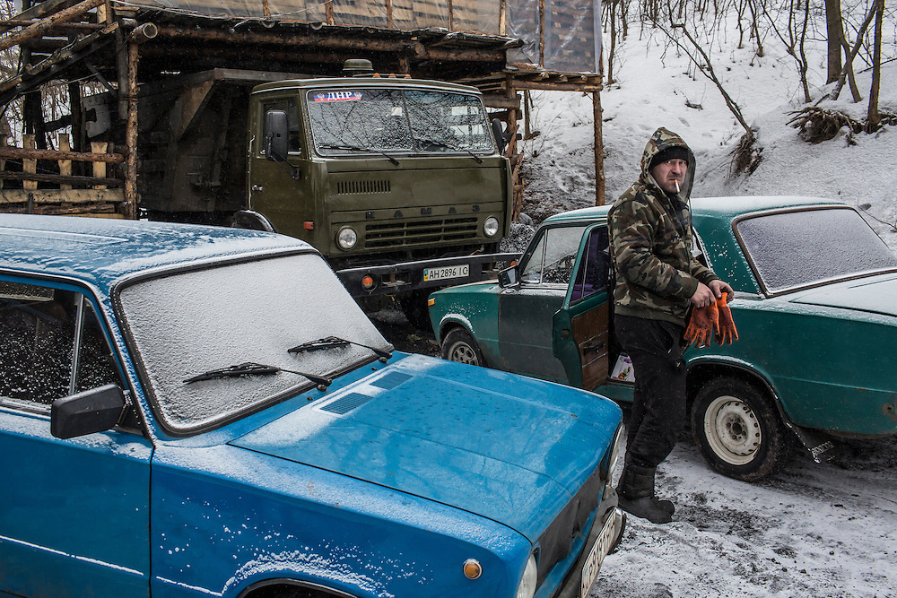 SNEZHNE, UKRAINE - JANUARY 25, 2015: A  man who works at a small private coal mine in the woods in Snezhne, Ukraine. The mine produces approximately 15 tons of coal per day with a crew of four men. CREDIT: Brendan Hoffman for The New York Times
