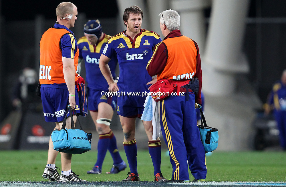 Ben Smith is attended too by the Highlanders medical staff.<br /> Investec Super Rugby - Highlanders v Stormers, 7 April 2012, Forsyth Barr Stadium, Dunedin, New Zealand.<br /> Photo: Rob Jefferies / photosport.co.nz