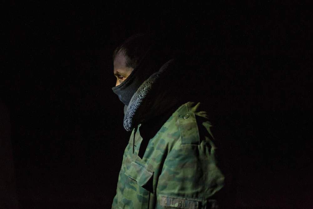 A pro-Russian rebel, released as a prisoner of war during a prisoner exchange with Ukrainian forces, walks between opposing front lines back to rebel territory on February 21, 2015 in Novotoshkivske, Ukraine. Ukrainian forces withdrew from the strategic and hard-fought town after being effectively surrounded by pro-Russian rebels, though fighting has caused widespread destruction.
