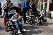 Families walk through Miniland in Legoland in Whitehaven, Florida on February 11, 2012.