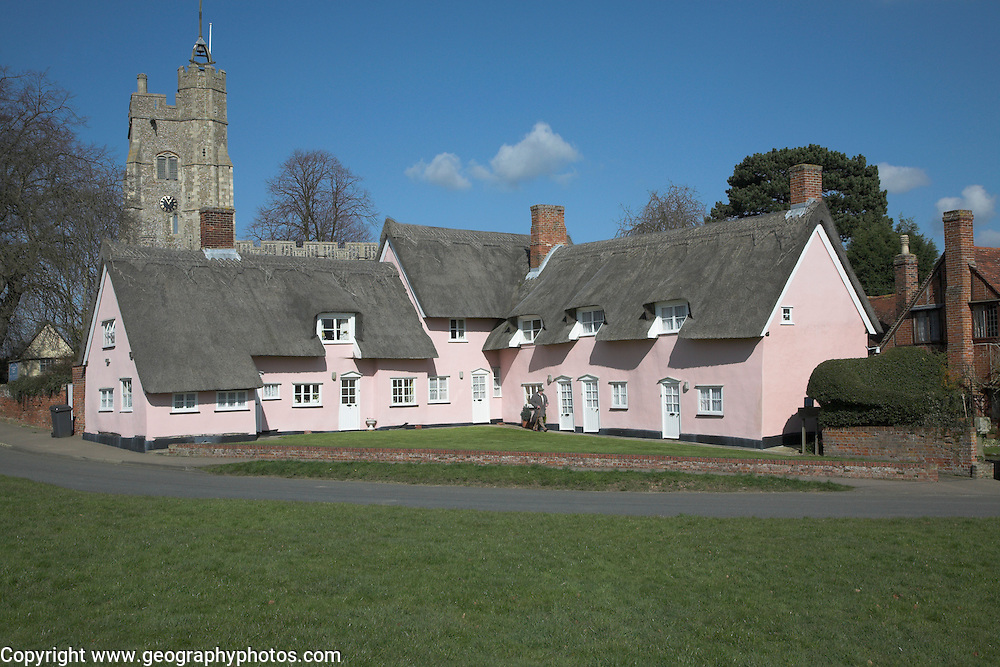 Famous Picturesque Pink Thatched Almshouse Cottages And St