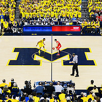 ANN ARBOR, MICHIGAN -- February 5, 2013 -- University of Michigan guard Trey Burke, left, and Ohio State University guard Aaron Craft face off at center court in Ann Arbor, Michigan.  The Wolverines won 76-74 in overtime.   (PHOTO / CHIP LITHERLAND)