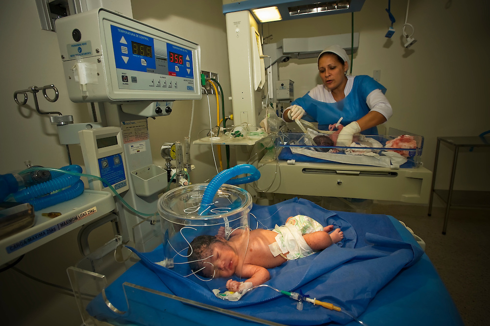A nurse at a government free maternity clinic tends to babies recently born to teen mothers in Caracas, Venezuela.