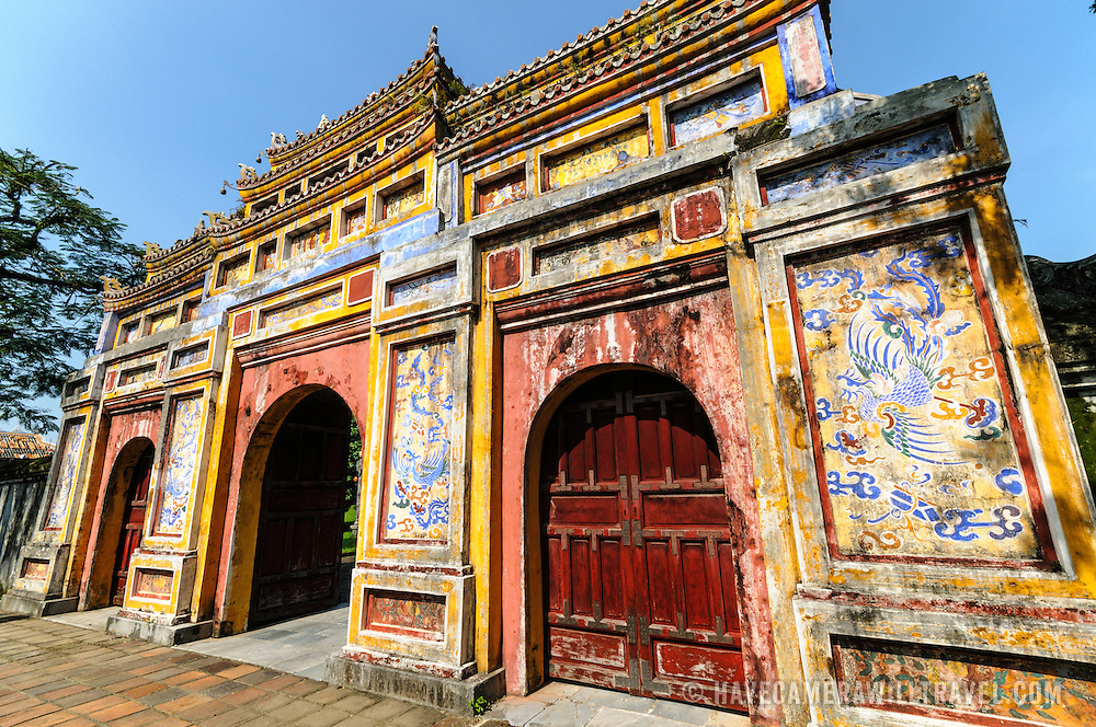 Gate at Dien Tho Residence at the Imperial City in Hue, Vietnam. A self-enclosed and fortified palace, the complex includes the Purple Forbidden City, which was the inner sanctum of the imperial household, as well as temples, courtyards, gardens, and other buildings. Much of the Imperial City was damaged or destroyed during the Vietnam War. It is now designated as a UNESCO World Heritage site.