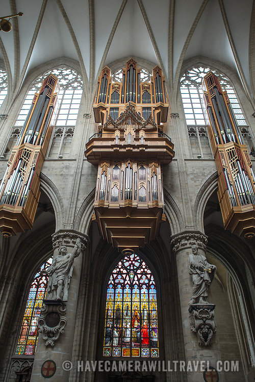 The pipe organ at the Cathedral of St. Michael and St. Gudula (in French, Co-Cathédrale collégiale des Ss-Michel et Gudule). A church was founded on this site in the 11th century but the current building dates to the 13th to 15th centuries. The Roman Catholic cathedral is the venue for many state functions such as coronations, royal weddings, and state funerals. It has two patron saints, St Michael and St Gudula, both of whom are also the patron saints of Brussels.