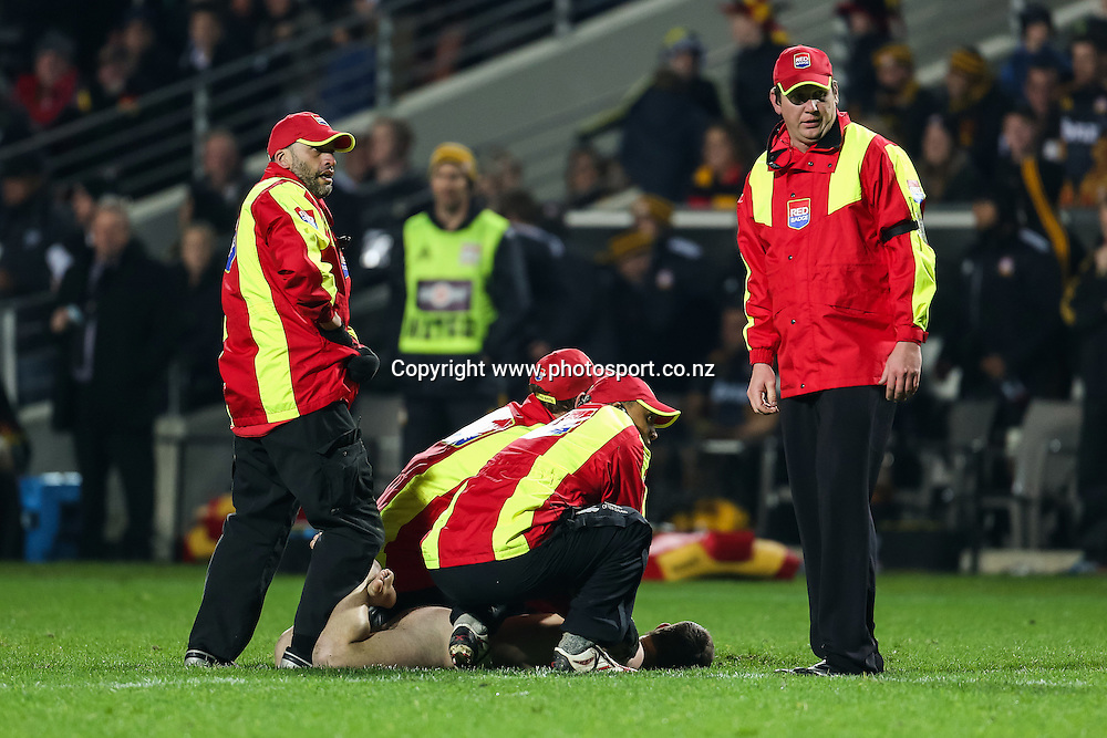 A streaker is apprehended by security during the Super 15 Rugby match - Chiefs v Hurricanes at Waikato Stadium, Hamilton, New Zealand on Friday 4 July 2014.  Photo:  Bruce Lim / www.photosport.co.nz
