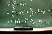 Detail of a chalkboard with mathematics written in chalk in Tucson, Arizona, USA.