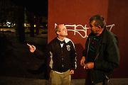 Norwegian writer Kristian Kahrs speaks with his neighbor Vlada Vasiljevic outside their block of flats in New Belgrade...Photographed for Plot Magazine.