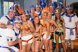 London, August 25th 2014. Revellers pose for a group photo as final touch ups to costumes are made as Notting Hill Carnival goers prepare to party despite the pouring rain.