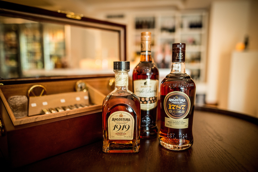 PORT OF SPAIN, TRINIDAD - FEBRUARY 15, 2017:  Bubbles Blends & Basics, a new wine and spirits shop that also functions as a bar, where you can find bottles of the country's most famous export, Angostura Rum (the 1919 is a popular choice). Throw in a bottle of Angostura Bitters while you're at it. PHOTO: Meridith Kohut for The New York Times