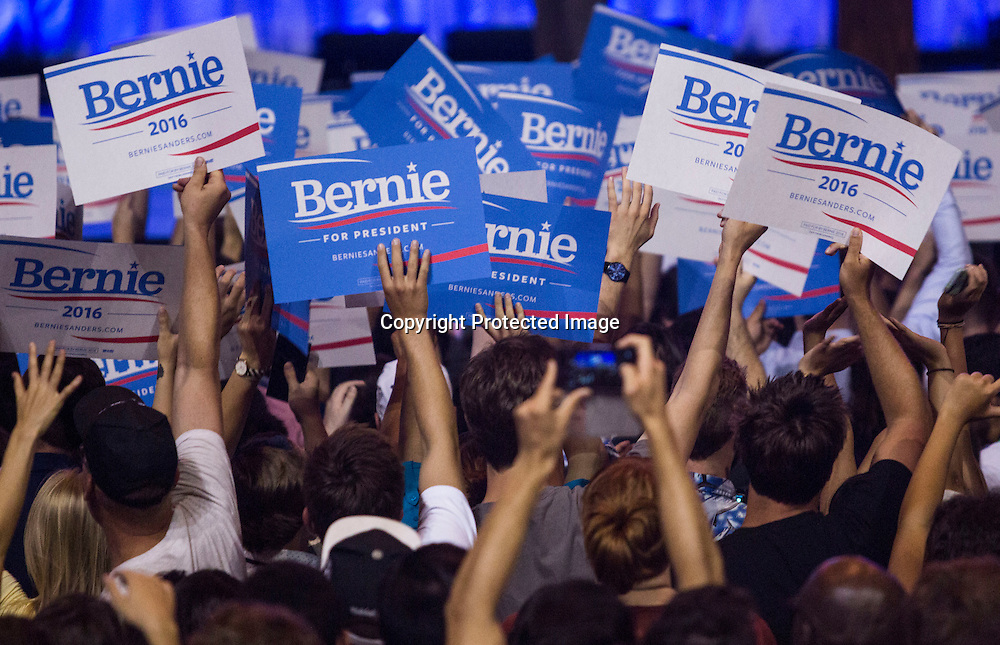 Supporters cheer during a rally for democratic presidential candidate Sen. Bernie Sanders, I-Vt., Monday, Aug. 10, 2015, at the Los Angeles Memorial Sports Arena in Los Angeles. (AP Photo/Ringo H.W. Chiu)