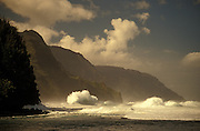 Storm surf on the Na Pali Coast, Kauai, Hawaii.