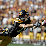 Scott Morgan/The Hawk Eye.Iowa's Ed Hinkle (11) dives for a pass in the first quarter Saturday, Sept. 3, 2005, during their game against Ball State in Iowa City. Iowa won the game 56-0.