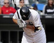 CHICAGO - SEPTEMBER 25:  Paul Konerko #14 of the Chicago White Sox is hit in the elbow by a pitch thrown by Luis Mendoza #39 of the Kansas City Royals in the sixth inning on September 25, 2011 at U.S. Cellular Field in Chicago, Illinois.  The Royals defeated the White Sox 2-1.  (Photo by Ron Vesely)   Subject: Paul Konerko;Luis Mendoza