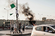 Libyan rebels  attack Bab Al Azizyia,  Gadhafi headquarters compound in Tripoli. Green flags of the Gadhafi's regime are stripped down outside the compound. 23 August 2011.