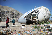 A school being rebuild in the center of the city next to the wreck of a russian cargo plane which was shot down by Al-Shabbab.