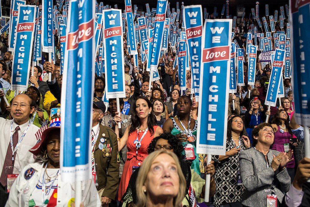 Delegates hold signs for First Lady Michelle Obama as she speaks at the Democratic National Convention on Tuesday, September 4, 2012 in Charlotte, NC.
