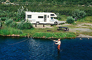 Alaska. Tangle Lakes Campground. Fishing for grayling along the Tangle River. MR. PR.