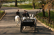 "Horse drawn caisson with the US Army Honor Guard sentries of the 3rd. US Infantry, known as ""The Old Guard"" proceeding after a military honors funeral in Arlington National Cemetery in Arlington, VA on Monday, April 18, 2005."
