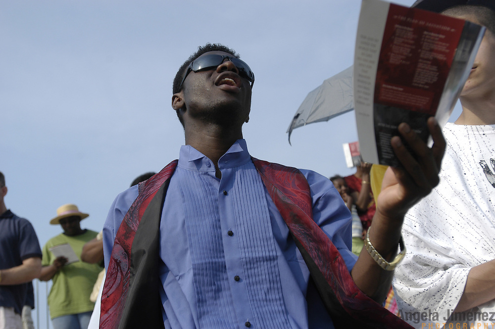 Kosj Yamoah, 25, a member of the Glad Tidings Tabernacle Church in Manhattan, sings during the last day of the Greater New York Billy Graham Crusade at Flushing Meadows Corona Park in Queens, New York City on June 26, 2005. The three day event was organized by the Billy Graham Evangelistic Association.