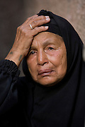 An Egyptian woman mourns family members killed by a giant rockslide in the Manshiyet Nasr shantytown Saturday, September 6, 2008 in Cairo, Egypt. 64 bodies have been recovered, yet hundreds more are believed buried under more than 70 tons of limestone, and authorities have struggled to bring in heavy equipment that might be used to retrieve more bodies or search for survivors. Residents of the area have grown increasingly angry with what they say is the Egyptian government's inability to respond to the disaster.