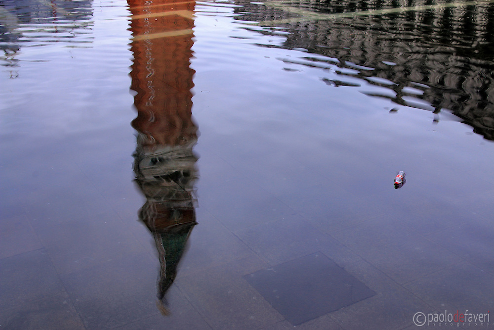 """The bell tower of San Marco reflected in the tide waters. Taken on an early morning at the end of January when the rising tide had already completely flooded the city, producing that phenomenon known as """"acqua alta""""."""