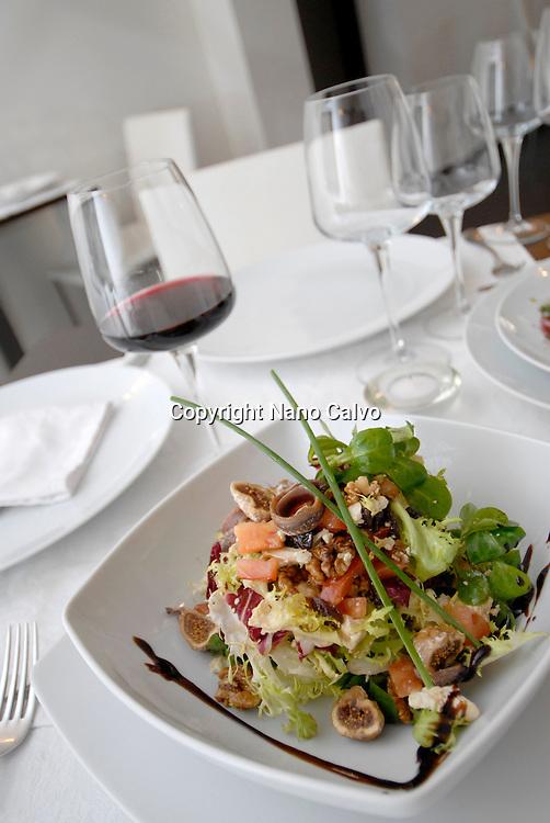 Creative and colorful salad and cup of wine in El Hall restaurant, Ibiza Photo by Nano Calvo - VWPics.com