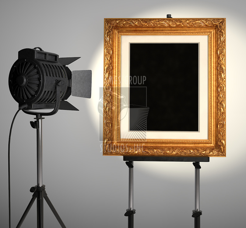 A spotlight lighting up a blank picture frame