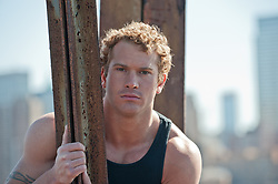 portrait of a man with curly hair in New York